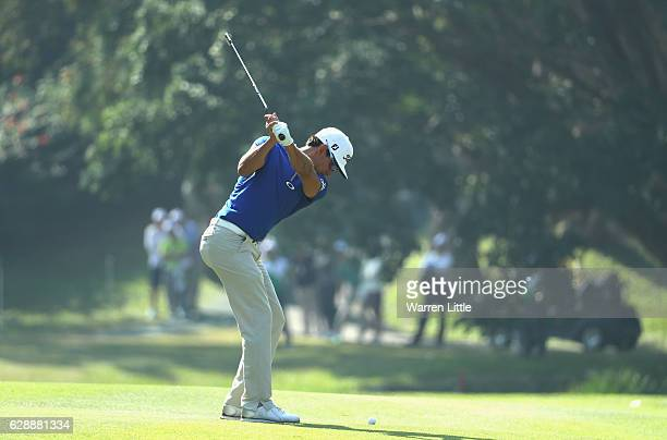 Rafa Cabrera Bello of SPain plays his third shot into the first green during the third round of the UBS Hong Kong Open at The Hong Kong Golf Club on...