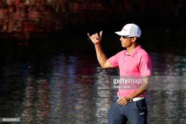 Rafa Cabrera Bello of Spain reacts to his birdie on the 17th green during the final round of THE PLAYERS Championship at the Stadium course at TPC...