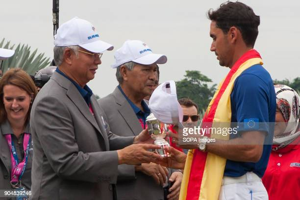 Rafa Cabrera Bello seen receiving a ceremonial gift from the Malaysia Prime Minister Najib Razak EurAsia Cup is a biennial men professional team golf...