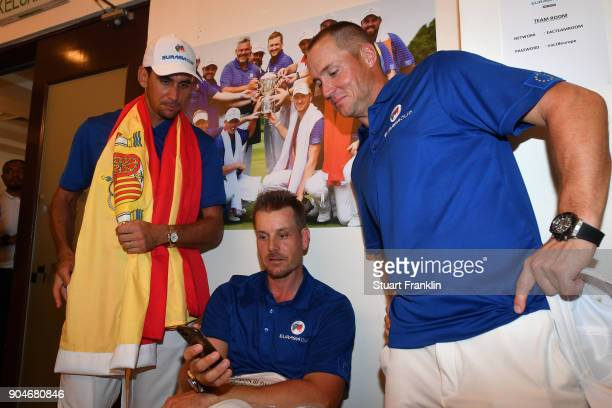 Rafa CabreraBello Henrik Stenson and Alex Noren of Europe look on following their team's victory during the singles matches on day three of the 2018...