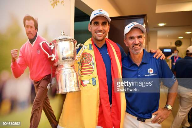 Rafa CabreraBello of Europe celebrates with the trophy and caddie Colin Byrne following his team's victory during the singles matches on day three of...