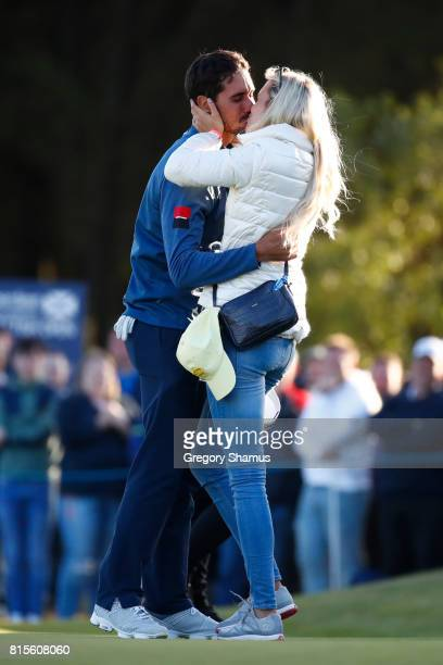 Rafa CabreraBello of Spain celebrates victory on the 1st play off hole with a kiss from girlfriend Sofia Lundstedt during the final round of the AAM...