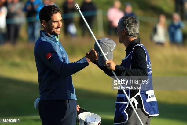 Rafa CabreraBello of Spain celebrates victory on the 1st play off hole with caddie Colin Byrne during the final round of the AAM Scottish Open at...