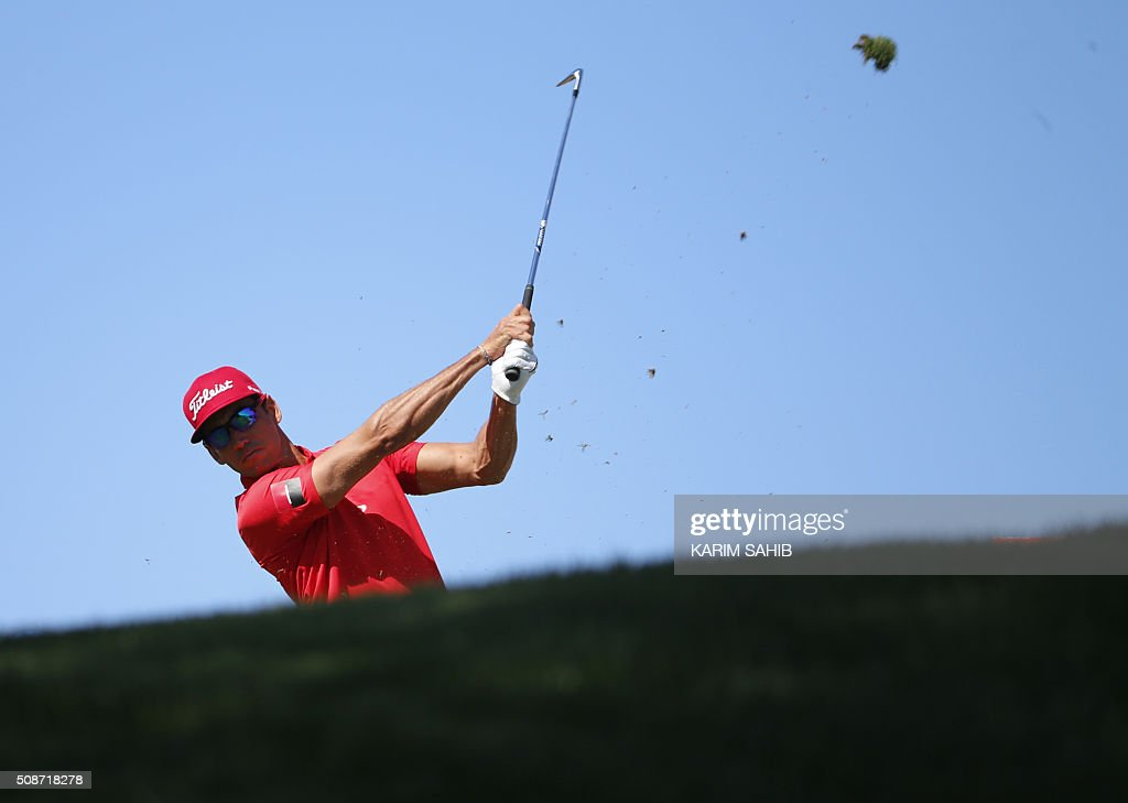 TOPSHOT - Rafa Cabrera-Bello of Spain plays a shot during the third round of the 2016 Dubai Desert Classic at the Emirates Golf Club in Dubai on February 6, 2016. / AFP / KARIM