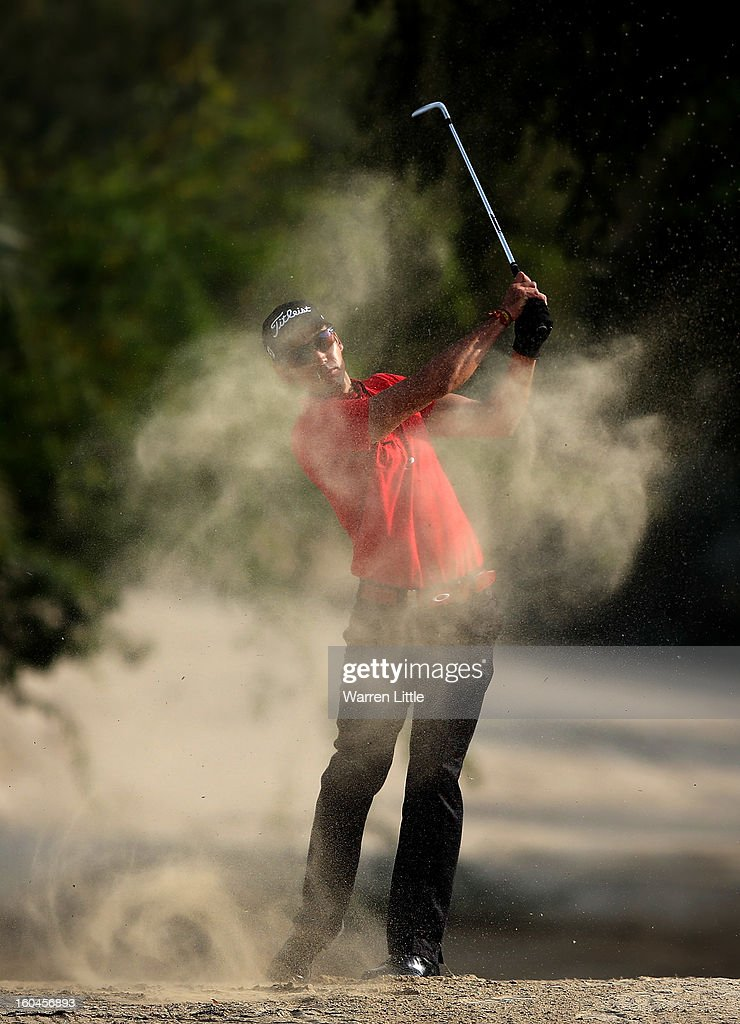 Rafa Cabrera-Bello of Spain plays out of the sand on the 14th hole during the second round of the Omega Dubai Desert Classic at Emirates Golf Club on February 1, 2013 in Dubai, United Arab Emirates.