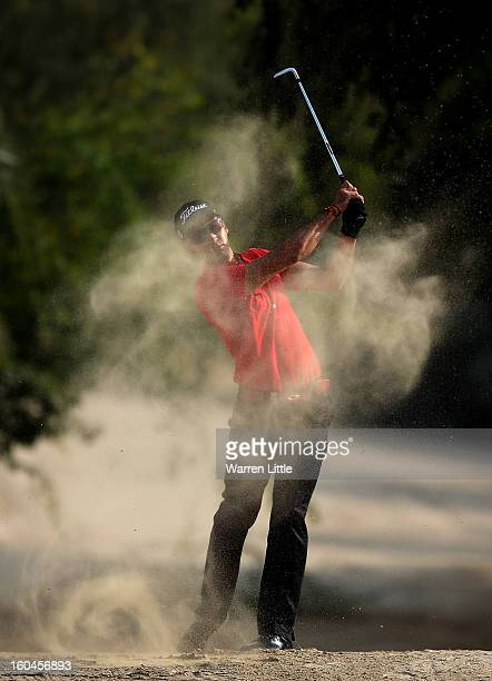 Rafa Cabrera-Bello of Spain plays out of the sand on the 14th hole during the second round of the Omega Dubai Desert Classic at Emirates Golf Club on...