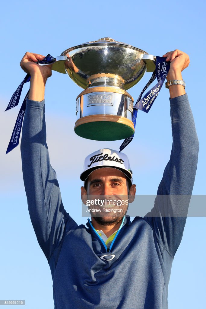 Rafa Cabrera-Bello of Spain poses with the trophy following his victory on the 1st play off hole during the final round of the AAM Scottish Open at Dundonald Links Golf Course on July 16, 2017 in Troon, Scotland.