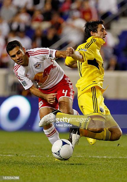 Rafa Marquez of the New York Red Bulls trips up Milovan Mirosevic of the Columbus Crew during the game at Red Bull Arena on September 15 2012 in...
