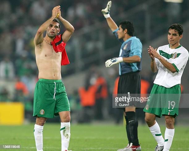 Rafa Marquez Oswaldo Sanchez and Omar Bravo say goodbye to the fans at the end of the game Mexico and Angola played to a 00 tie in their Group D...
