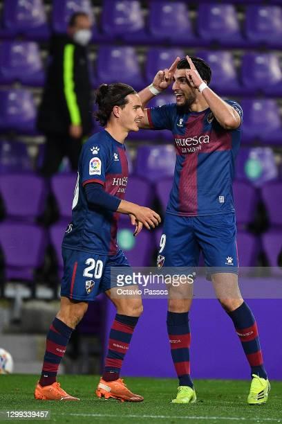 Rafa Mir of Huesca celebrates scoring their third goal during the La Liga Santander match between Real Valladolid CF and SD Huesca at Estadio...