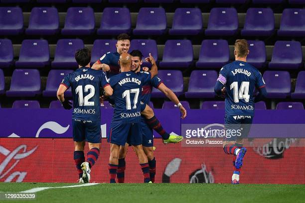 Rafa Mir of Huesca celebrates with team mates after scoring the opening goal during the La Liga Santander match between Real Valladolid CF and SD...
