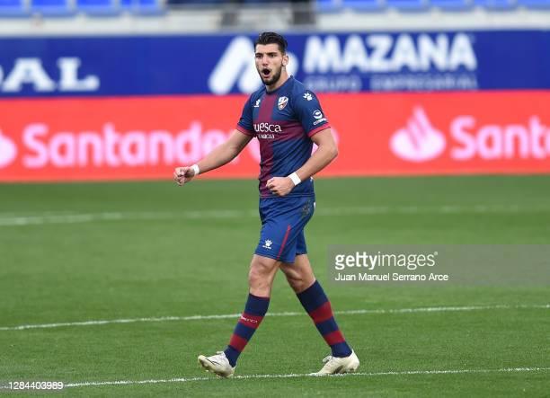 Rafa Mir of SD Huesca celebrates after scoring his team's first goal during the La Liga Santander match between SD Huesca and SD Eibar at Estadio El...
