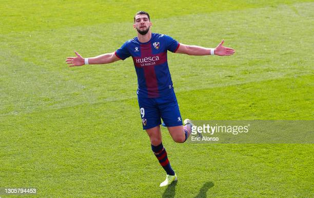 Rafa Mir of SD Huesca celebrates after scoring their side's second goal during the La Liga Santander match between SD Huesca and RC Celta at Estadio...