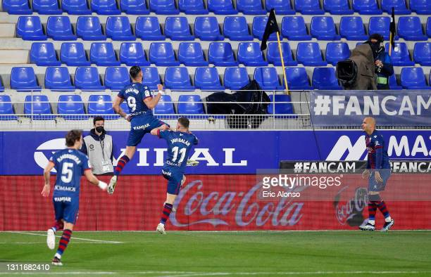Rafa Mir of SD Huesca celebrates after scoring their team's first goal during the La Liga Santander match between SD Huesca and Elche CF at Estadio...
