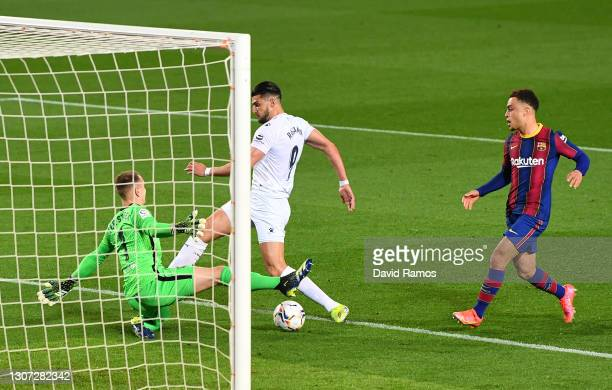 Rafa Mir of SD Huesca is fouled by Marc-Andre ter Stegen of FC Barcelona leading to a penalty being awarded during the La Liga Santander match...