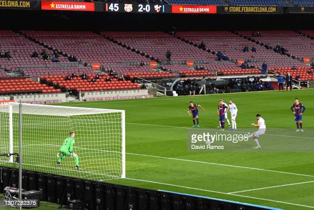 Rafa Mir of SD Huesca scores their side's first goal from the penalty spot past Marc-Andre ter Stegen of FC Barcelona during the La Liga Santander...