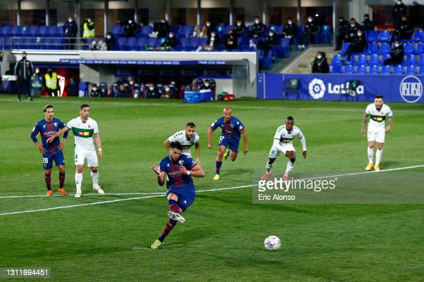Rafa Mir of SD Huesca scores their team's third goal from the penalty spot during the La Liga Santander match between SD Huesca and Elche CF at...