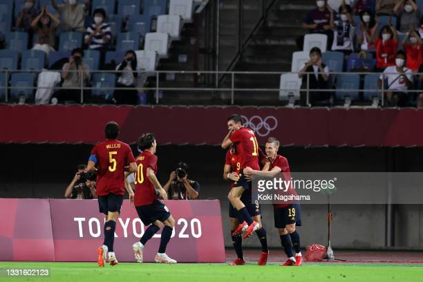 Rafa Mir of Team Spain celebrates with teammates after scoring their side's second goal during the Men's Quarter Final match between Spain and Cote...