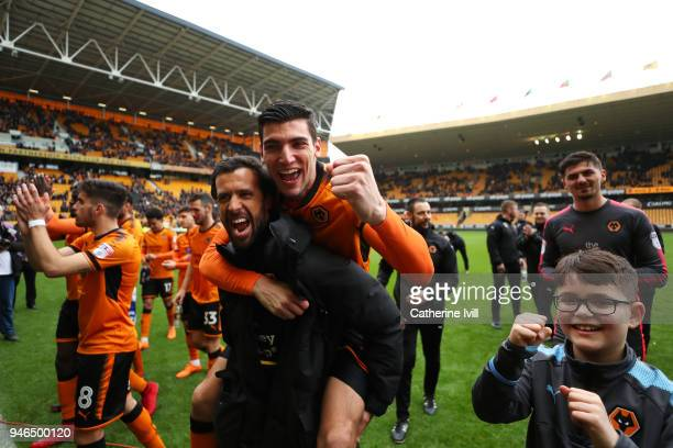 Rafa Mir of Wolverhampton Wanderers celebrates victory and celebrates getting promoted to the Premier League during the Sky Bet Championship match...