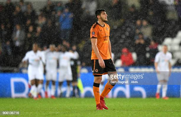 Rafa Mir of Wolverhampton Wanderers stands dejected after the first goal during The Emirates FA Cup Third Round Replay between Swansea City and...