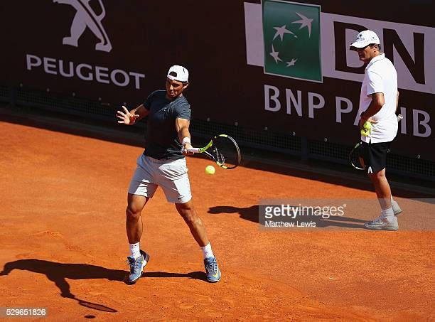 Rafa Nadal of Spain prctises as his coach Toni Nadal looks on during day two of The Internazionali BNL d'Italia 2016 on May 09 2016 in Rome Italy
