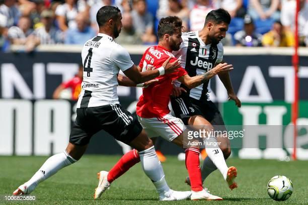 Rafa of Benfica battles for the ball between Mehdi Benatia of Juventus and Emre Can of Juventus during the International Champions Cup 2018 match...