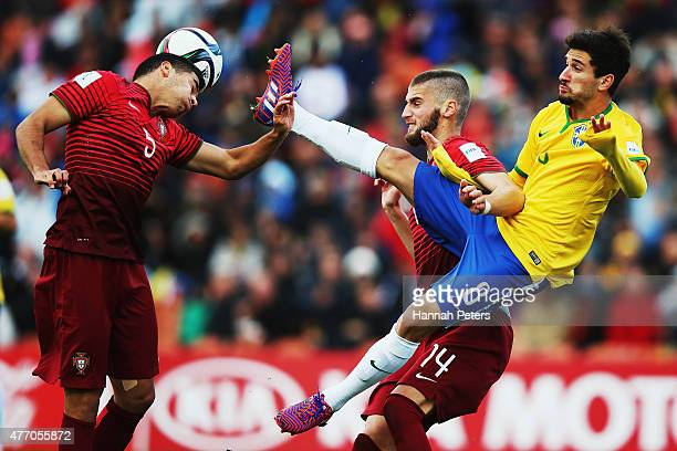 Rafa of Portugal heads the ball as Gabriel Boschilia of Brazil defends during the FIFA U20 World Cup New Zealand 2015 quarter final match between...