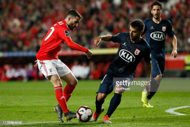 Rafa Silva of Benfica vies for the ball with Andre Santos of Belenenses during the Portuguese League football match between SL Benfica and Belenenses...