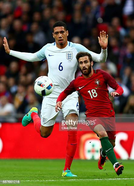 Rafa Silva of Portugal holds off pressure from Chris Smalling of England during the international friendly match between England and Portugal at...