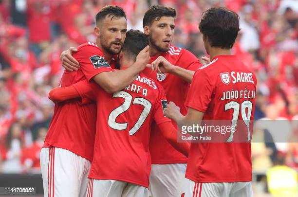 Rafa Silva of SL Benfica celebrates with teammates after scoring a goal during the Liga NOS match between SL Benfica and CD Santa Clara at Estadio da...