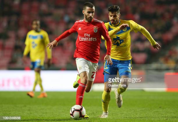 Rafa Silva of SL Benfica fights for the ball with Bruno Alves of FC Arouca during the Taca de Portugal match between SL Benfica and Arouca FC at...