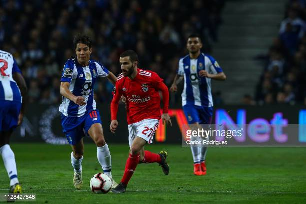 Rafa Silva of SL Benfica tries to escape Oliver Torres of FC Porto during the Liga NOS match between FC Porto and SL Benfica at Estadio do Dragao on...