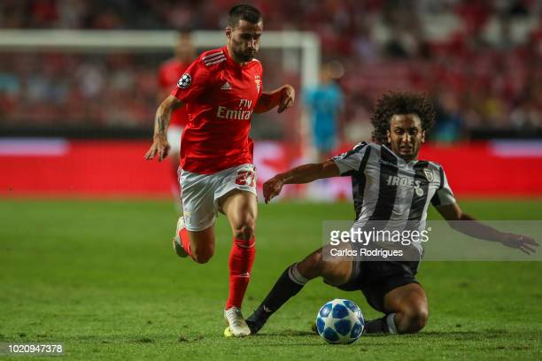 Rafa Silva of SL Benfica vies with Amr Warda of PAOK for the ball possession during the match between SL Benfica and PAOK for the UEFA Champions...
