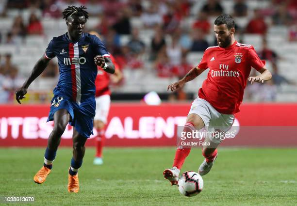 Rafa Silva of SL Benfica with Mama Balde of Desportivo das Aves in action during the Liga NOS match between SL Benfica and CD Aves at Estadio da Luz...
