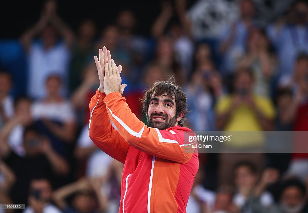 Rafael Aghayev of Azerbaijan celebrates during the medal ceremony for the Men's Kumite -75kg on day one of the Baku 2015 European Games at Crystal Hall on June 13, 2015 in Baku, Azerbaijan.