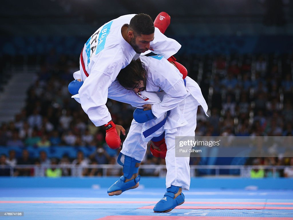 Rafael Aghayev of Azerbaijan (blue) competes with Luigi Busa of Italy (red) during the Men's Kumite -75kg gold medal match on day one of the Baku 2015 European Games at Crystal Hall on June 13, 2015 in Baku, Azerbaijan.