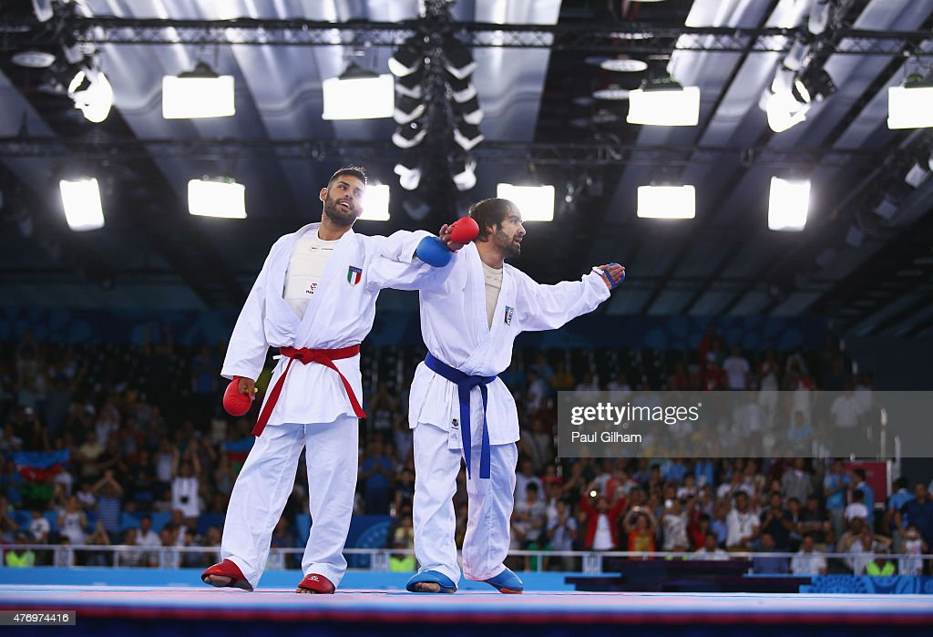 Rafael Aghayev of Azerbaijan (blue) looks on after defeating Luigi Busa of Italy (red) in the Men's Kumite -75kg gold medal match on day one of the Baku 2015 European Games at Crystal Hall on June 13, 2015 in Baku, Azerbaijan.