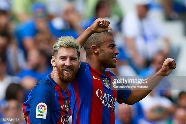 Rafael Alcantara alias Rafinha of FC Barcelona celebrates scoring their fifth goal with teammate Lionel Messi during the La Liga match between...