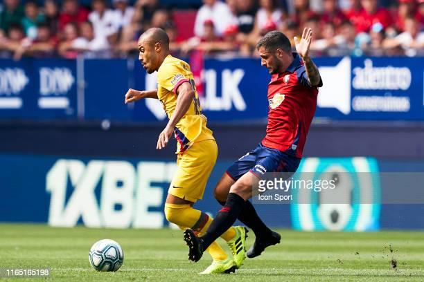 Rafael Alcantara of FC Barcelona and Fran Merida of CA Osasuna during the Liga match between Osasuna and Barcelona at El Sadar Stadium on August 31,...