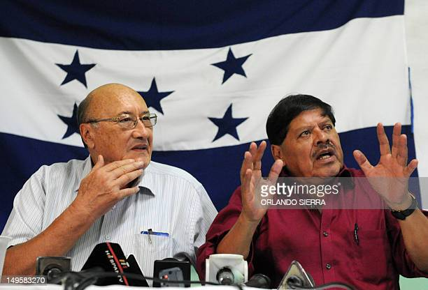 Rafael Alegria and Carlos Reyes leaders of the Frente Nacional de Resistencia Popular answer questions during a press conference in Tegucigalpa on...