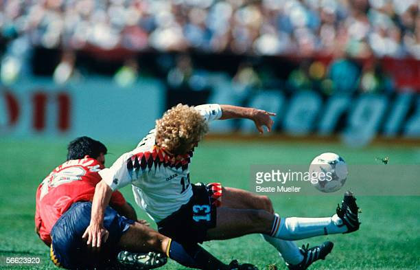 Rafael Alkorta of Spain and Rudi Voeller of Germany in action during the World Cup match between Germany and Spain on June 21 1994 in Chcago United...