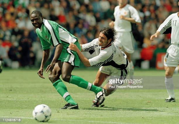 Rafael Alkorta of Spain attempts to bring down Rasheed Yekini of Nigeria during the 1998 FIFA World Cup Group D match at the Stade de la Beaujoire on...