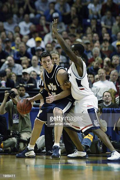 Rafael Araujo of the Brigham Young University Cougars posts up against Emeka Okafor of the University of Connecticut Huskies during the first round...