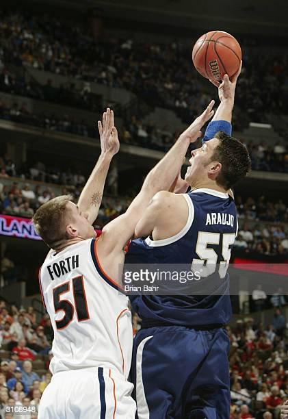 Rafael Araujo of the BYU Cougars from Brazil hooks a shot over Craig Forth of the Syracuse Orangeman during their first round game of the NCAA...