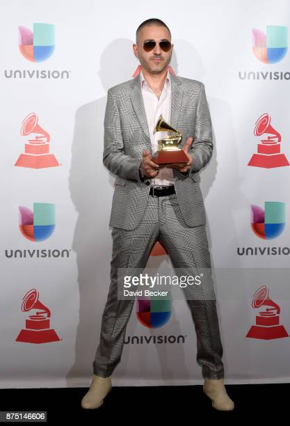 Rafael Arcaute poses with the award for Best Urban in the press room during The 18th Annual Latin Grammy Awards at MGM Grand Garden Arena on November...