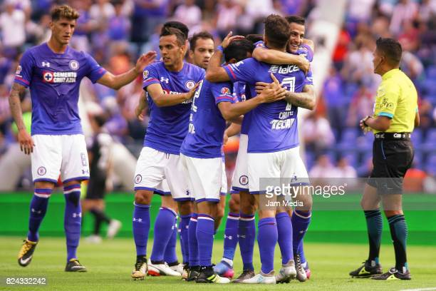 Rafael Baca of Cruz Azul celebrates with teamamtes after scoring his team's first goal during the 2nd round match between Cruz Azul and Chivas as...