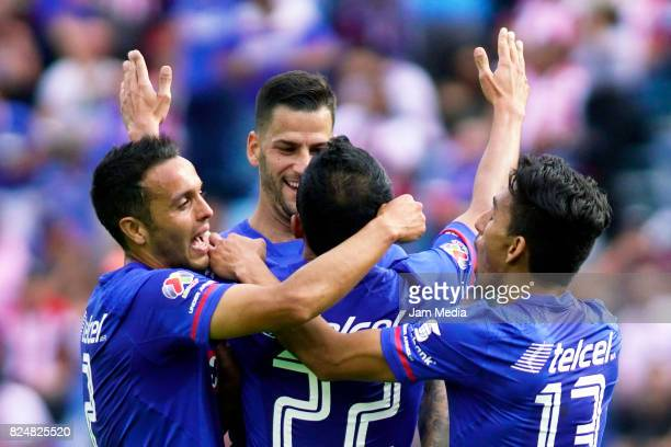 Rafael Baca of Cruz Azul celebrates with teammates after scoring during the second round match between Cruz Azul and Chivas as part of the Torneo...