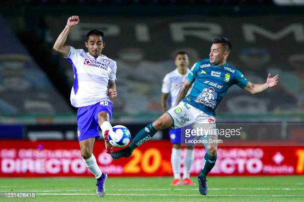 Rafael Baca of Cruz Azul competes for the ball with Jean Meneses of Leon during the 8th round match between Leon and Cruz Azul as part of the Torneo...