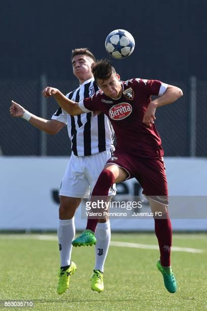 Rafael Bandeira Da Fonseca of Juventus U17 competes for a header with Gabriele Savino of Torino FC U17 during the match between Juventus U17 v Torino...