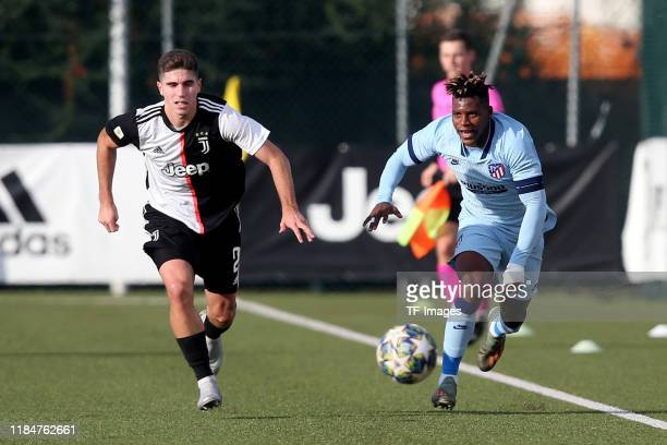 Rafael Bandeira of Juventus Turin U19 and Cedric Teguia of Atletico Madrid U19 battle for the ball during the UEFA Youth League match between...